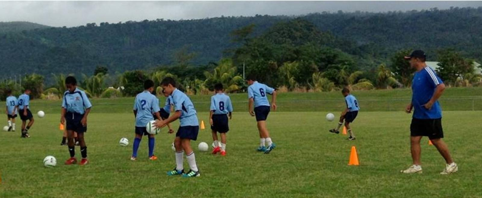 Children do football drills during a training session led by a Projects Abroad volunteer sports coach in Samoa.